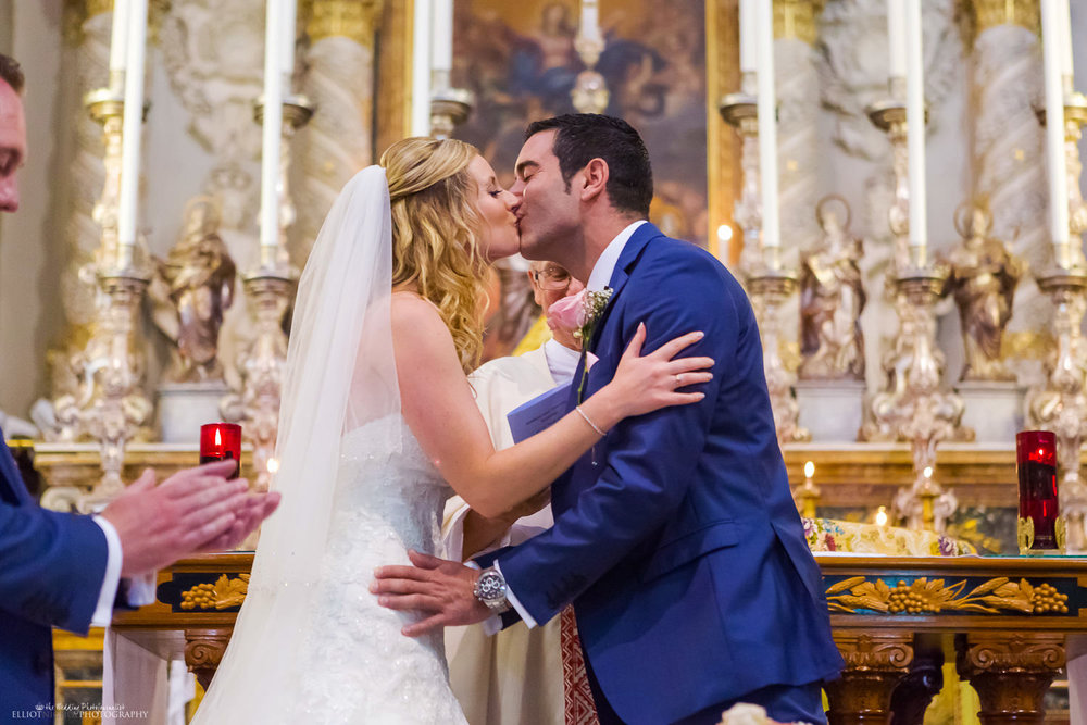 newlyweds kiss after saying wedding vows