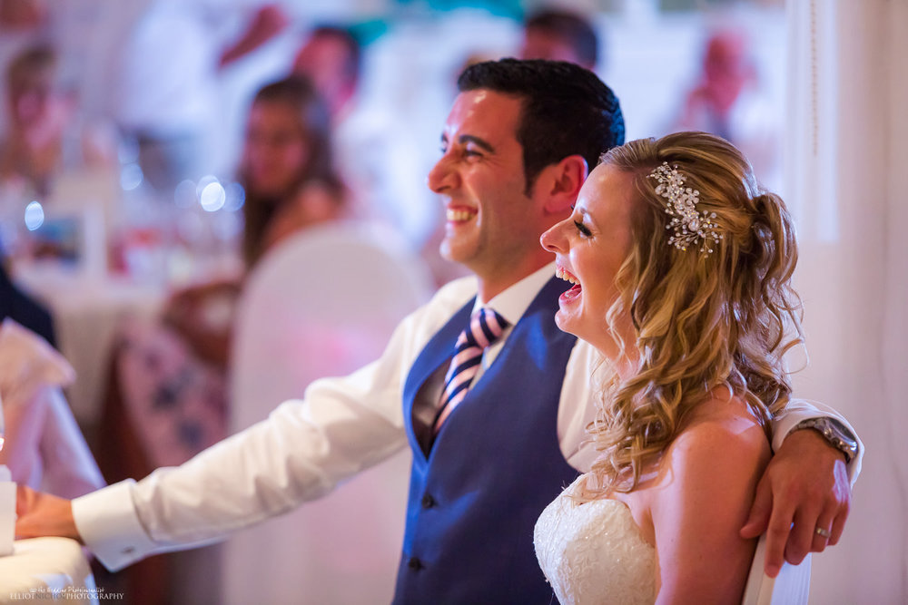 Bride and groom laughing during wedding reception at Villa Arrigo, Malta