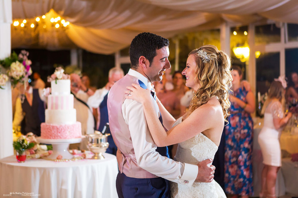 Newlyweds take their first dance as husband and wife