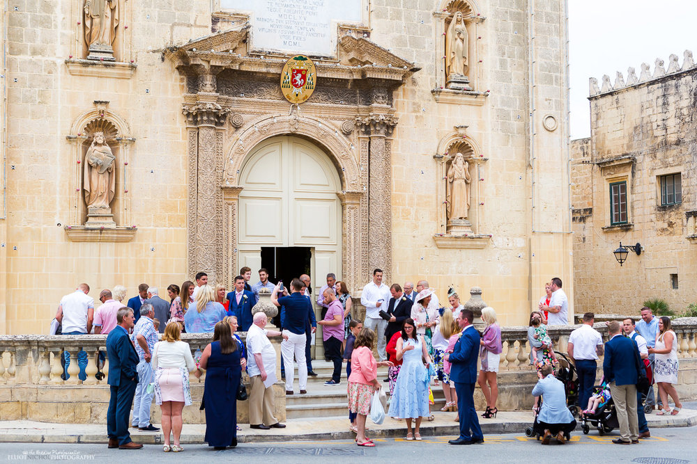 Wedding guests outside St Mary Parish Church in Attard, Malta.