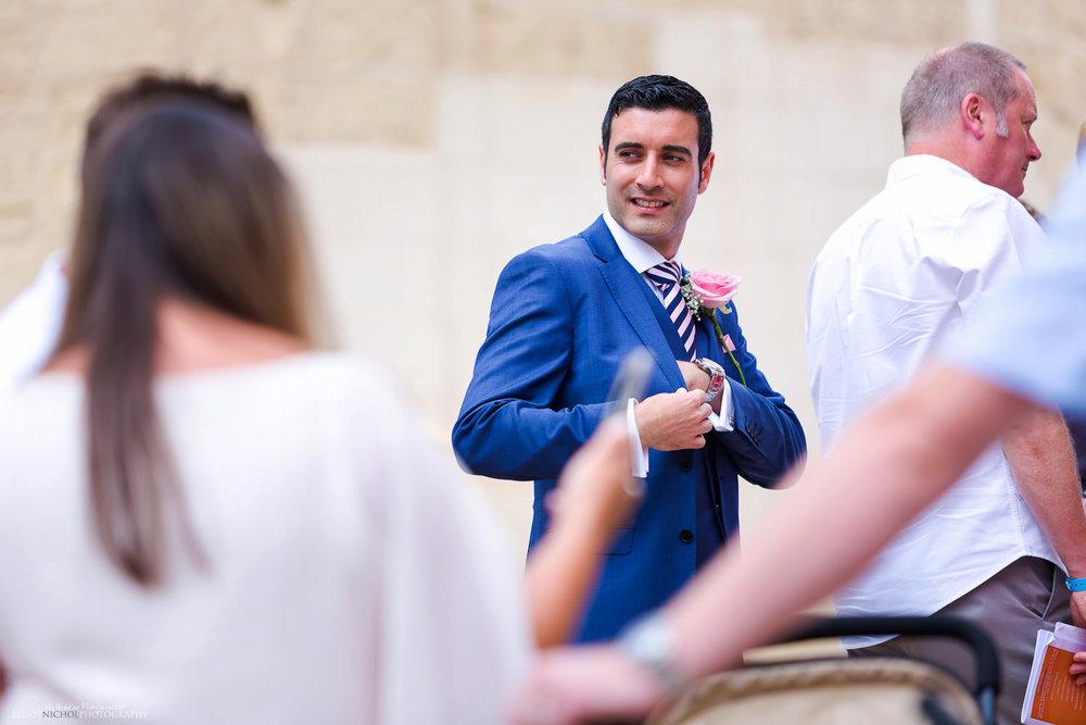 groom outside the parish church in Attard, Malta