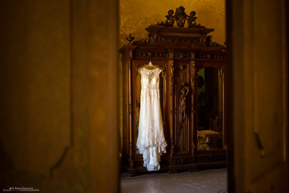 Wedding dress hanging on the wardrobe in the bridal suite and bedroom of the Palazzo Parisio, Naxxar, Malta