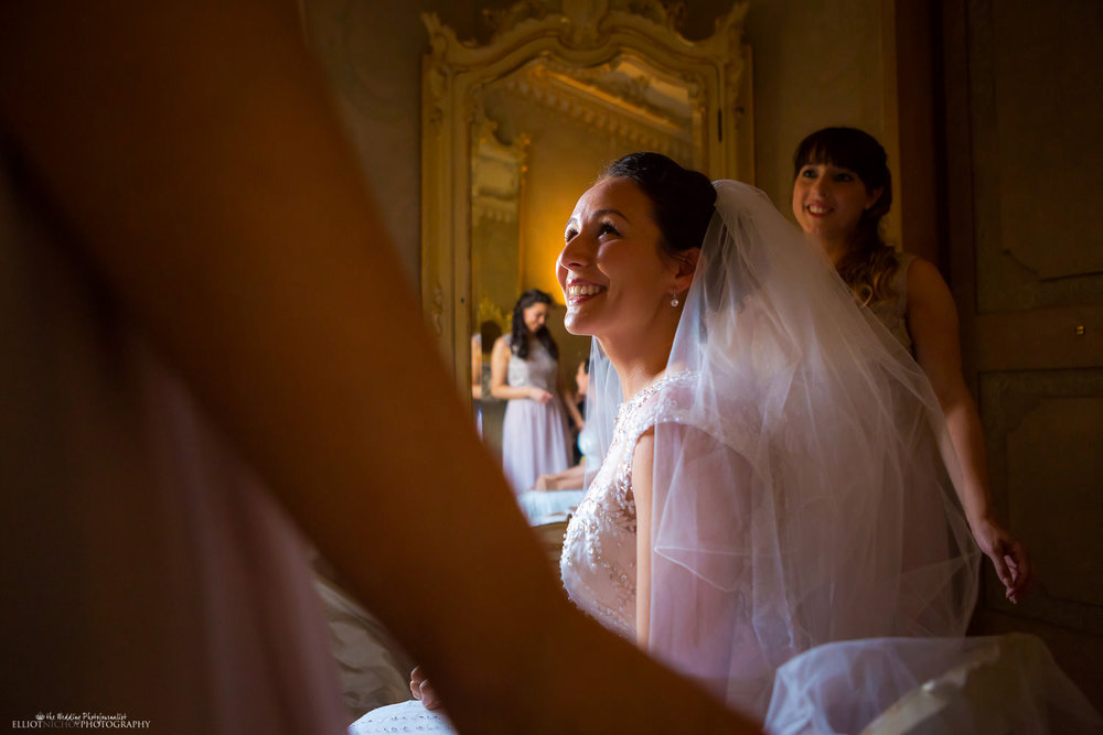 Happy bride after her veil has been fixed in place while in the Bridal Suite in the Palazzo Parisio, Malta.