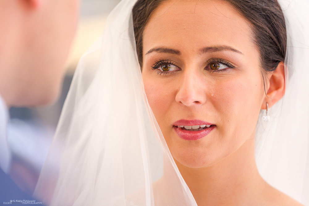 Bride cries a tear of happiness during an emotional wedding ceremony.