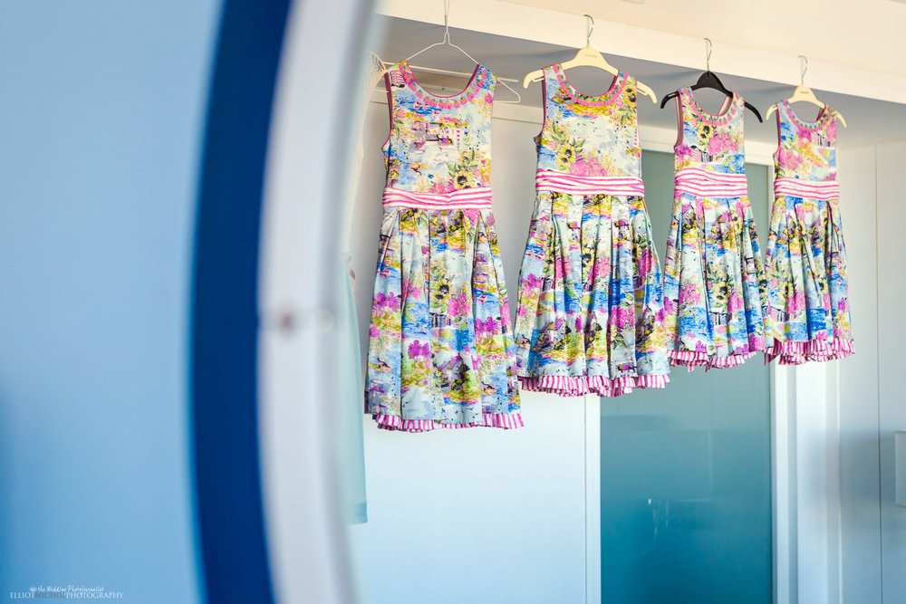 Flower girl dresses hanging in hotel room at Seabank Hotel, Malta.