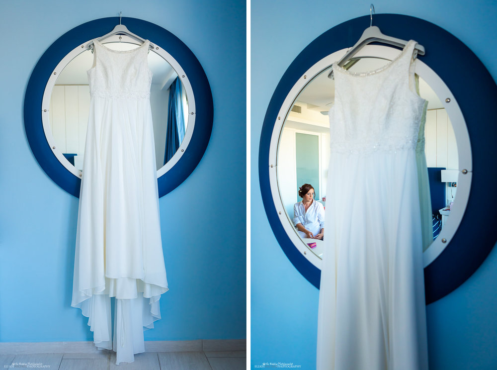 Brides wedding dress handing on the round mirror in the Seabank hotel, Malta.