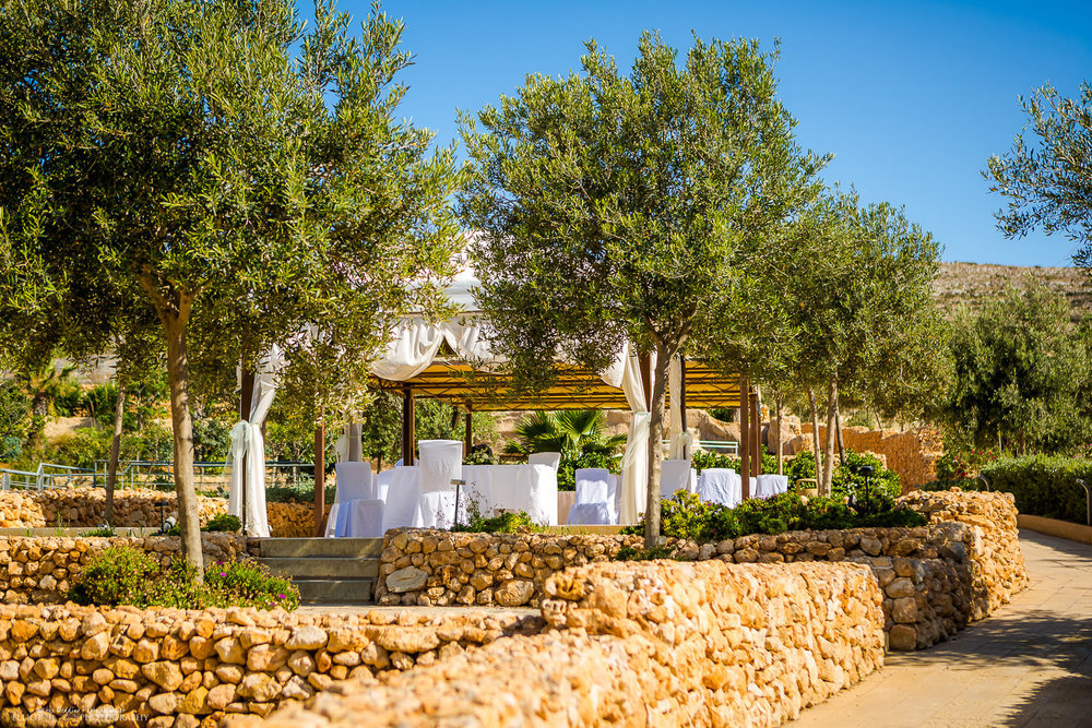 Seabank's Gazebo Terrace wedding ceremony setting with wedding setup, Mellieha, Malta.