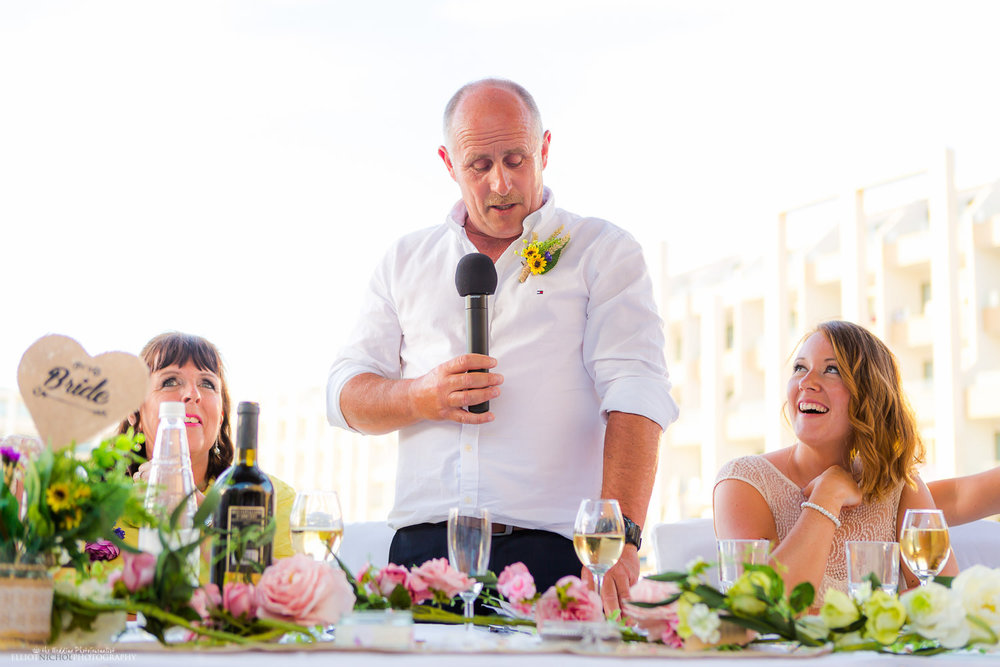 Father of the bride performs his wedding speech at the Seabank, Malta