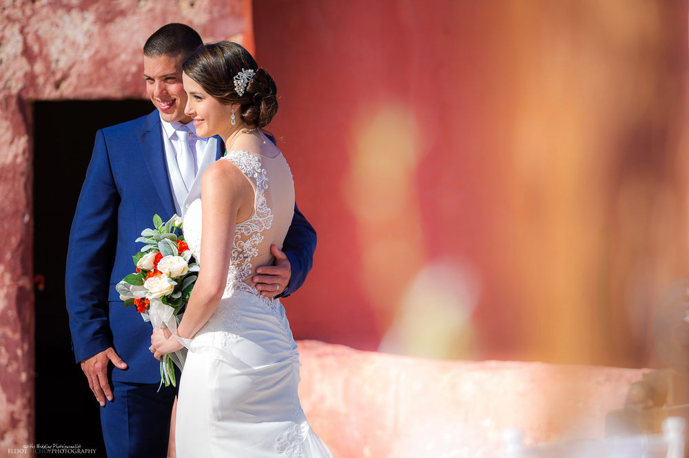 Candid portrait of newlyweds after the wedding ceremony on the roof of St Agatha's Tower (the red tower) in Mellieha, Malta