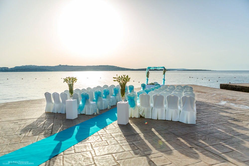 Wedding ceremony setup by the sea at the Dolmen Resort Hotel's Amazonia Lower Deck, Qawra, St Paul's Bay, Malta.