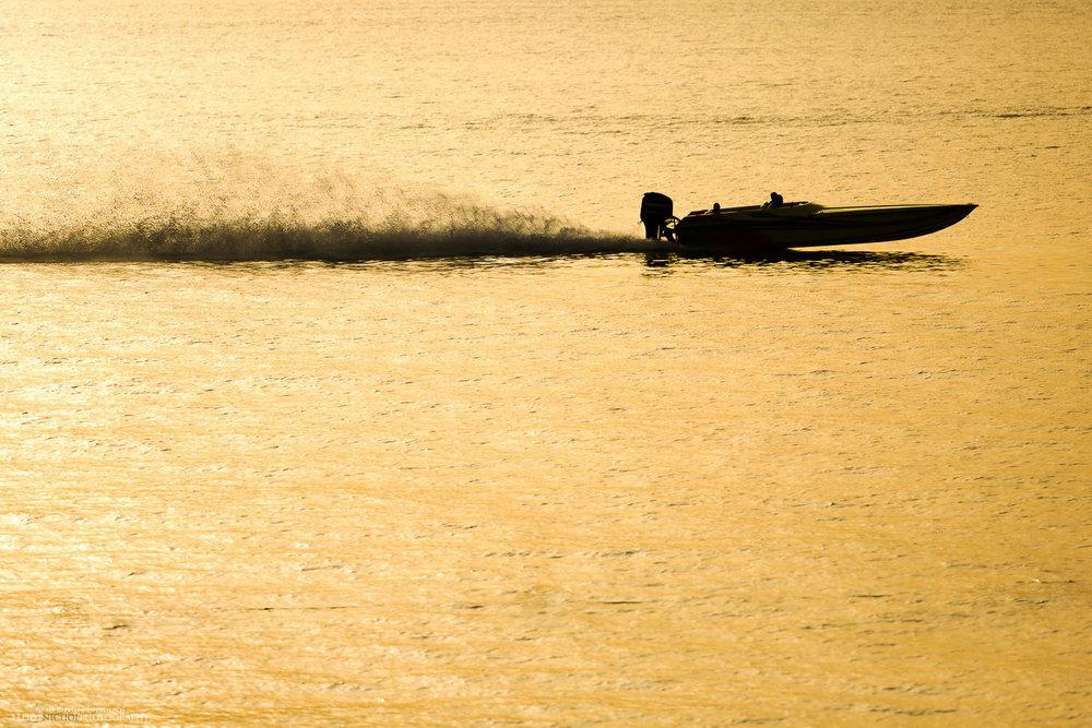 Speedboat in Malta zooms past the wedding destination ceremony at the Dolmen Hotel.