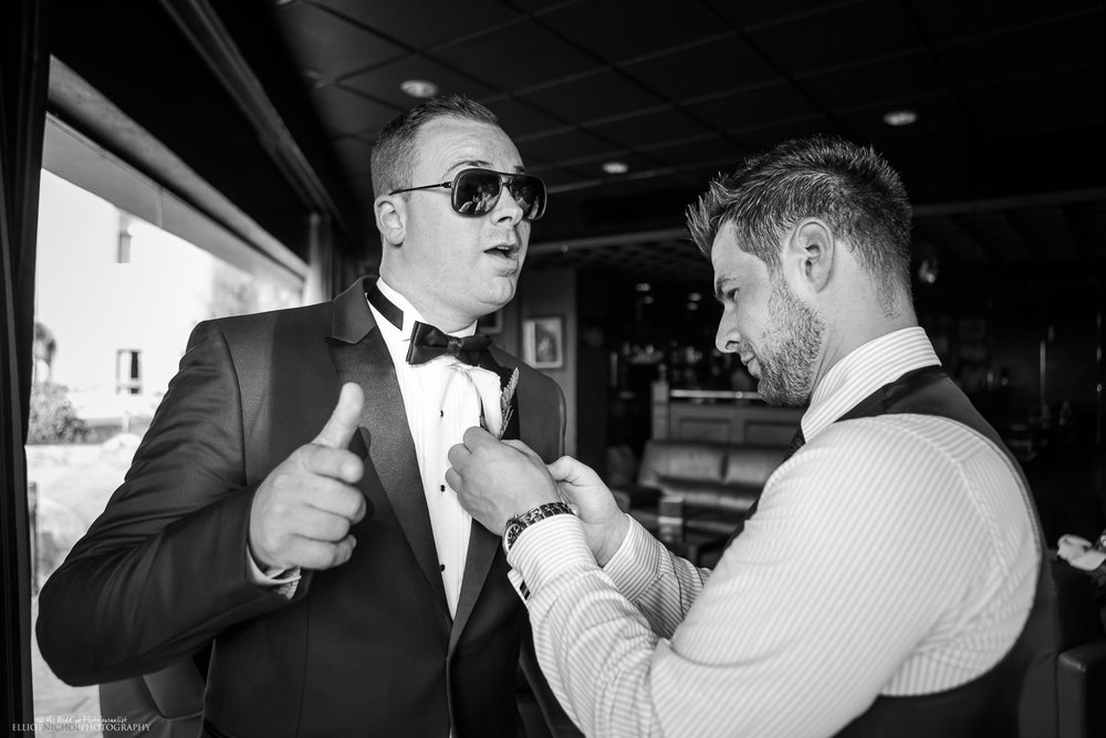 Groom getting ready with his bestman