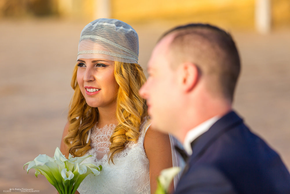 Bride and Groom sit during the wedding ceremony at the Dolmen Hotel, Malta.