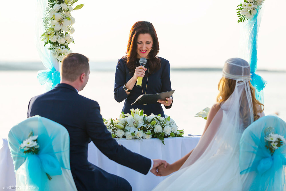Registrar with bride and Groom during the wedding ceremony but the sea in Malta.
