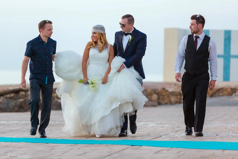 Bride and Groom walking with their Bestman &Bridesman.