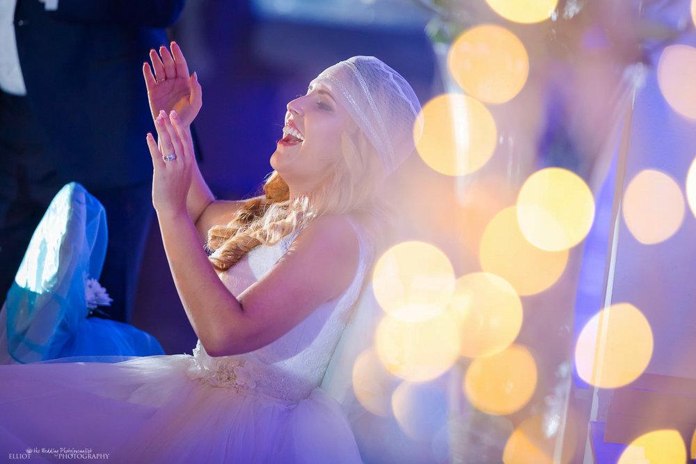 Bride's reaction to her husband's wedding speech at their wedding reception at the Dolmen Hotel, Malta.
