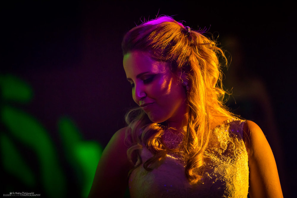 Bride partying and dancing at the Mynt Club at the Dolmen hotel at her wedding after aprty
