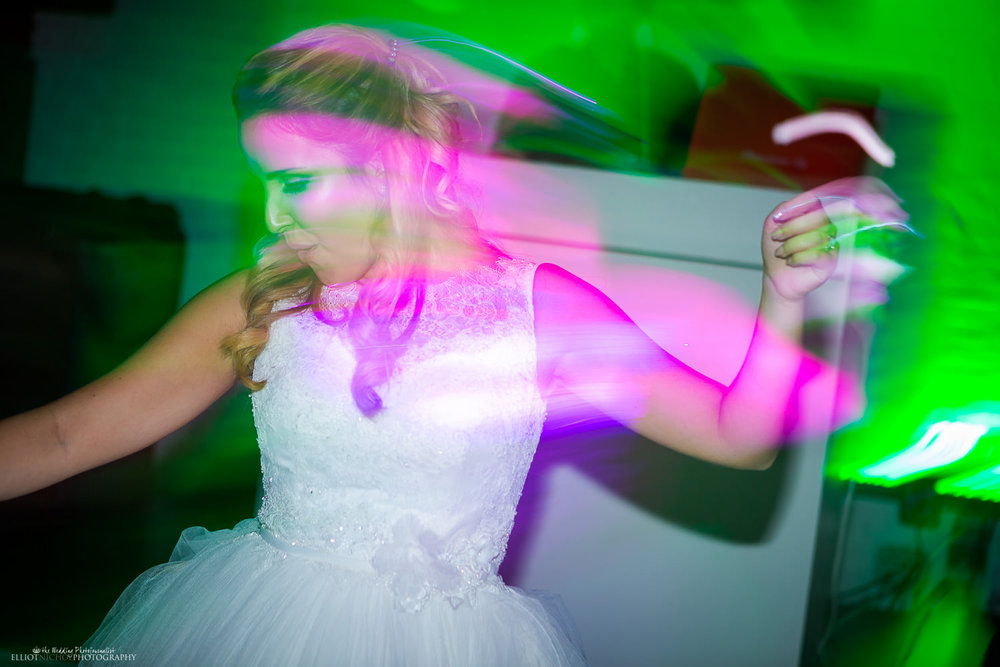 Bride dancing at her wedding afterparty in Malta