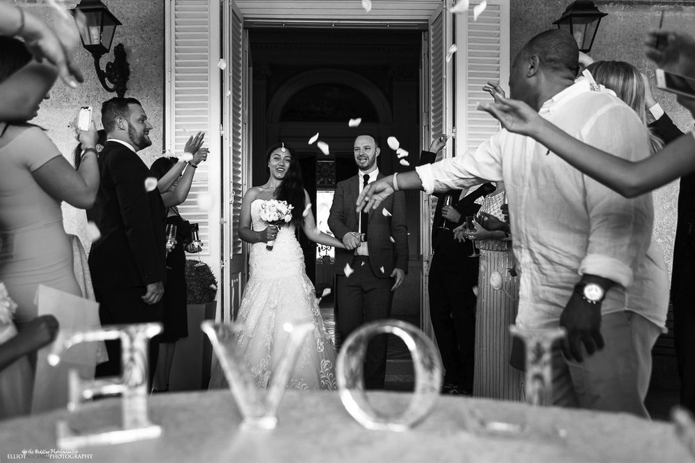 Bride & Groom showered in confetti on the Balcony Terrace at the Palazzo Parisio.