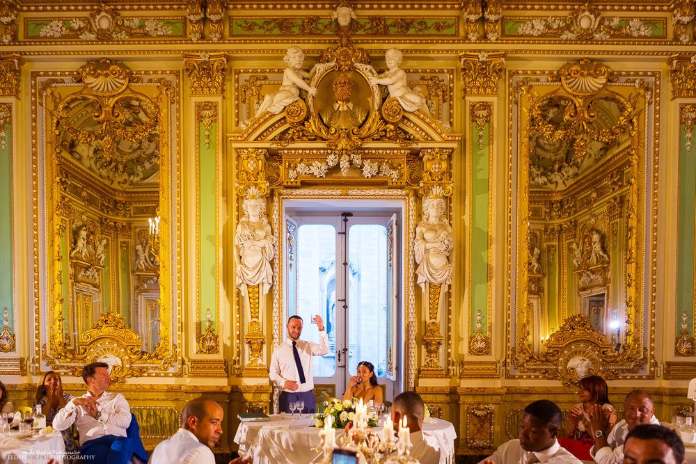 groom raises his glass to toast the bride and his wedding guests in the ballroom at the Palazzo Parisio