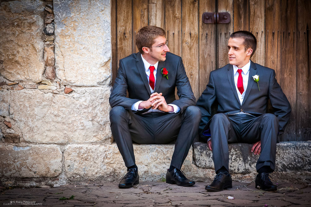 Groom and his best man waiting on the doorstep of the Palazzo Duchi di Santo Stefabo, Taormina, Sicily.