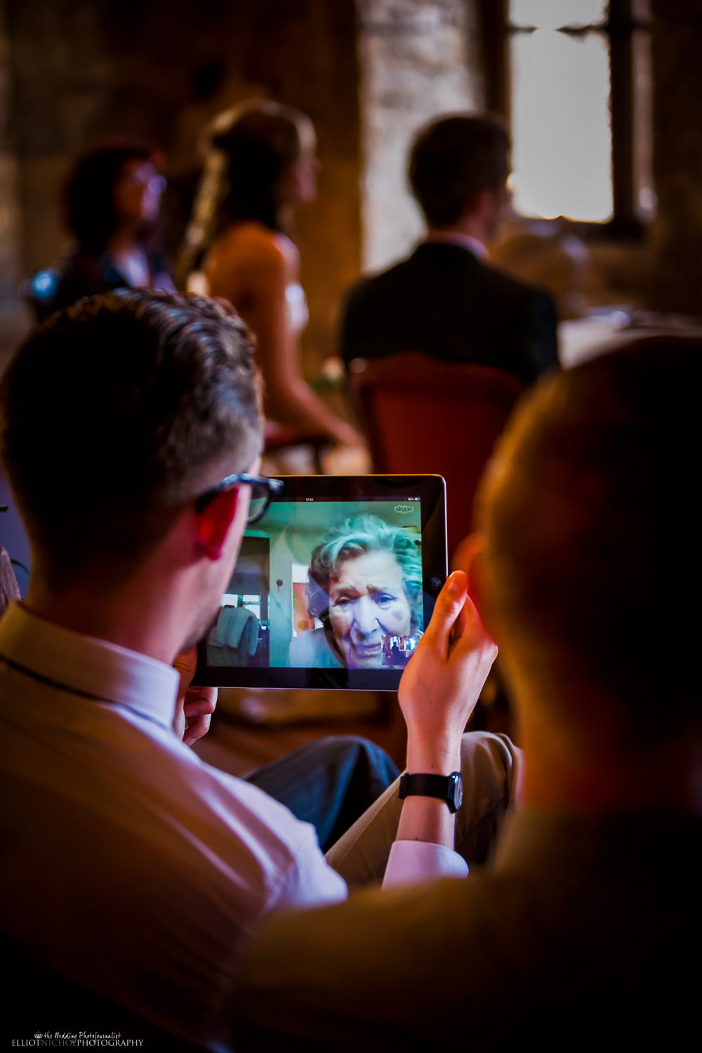 Grandparent able to watch the destination wedding ceremony in Sicily via Skype on an iPad.