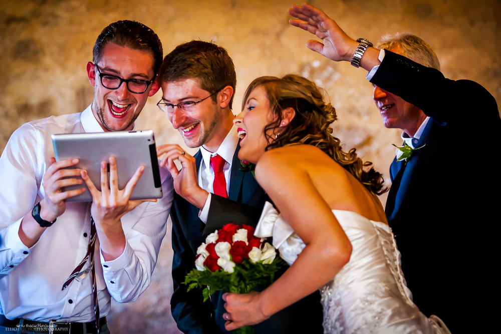 Talking with family on a video call through an iPad after the destination wedding ceremony in Taormina, Sicily.