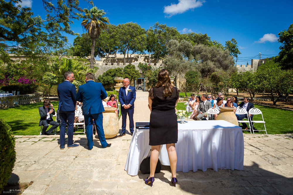 Grooms and guests at the wedding ceremony in the Baroque Gardens of the Villa Bologna, Malta.
