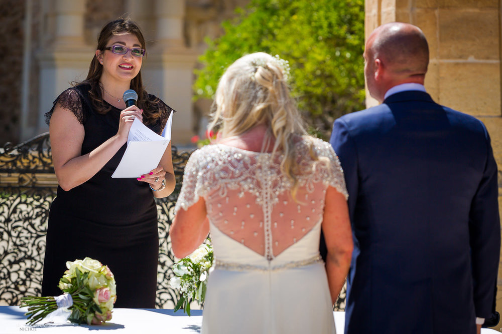 Marriage registrar with bride and groom during the wedding ceremony at the Villa Bologna, Malta