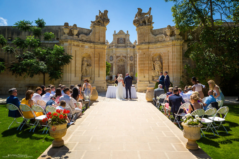 Bride & Groom together at their wedding ceremony in the Baroque Gardens at the Villa Bologna, Attard in Malta.