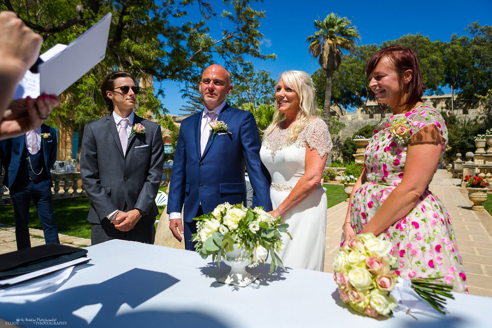 Bride & groom stand with their witnesses during their wedding ceremony.