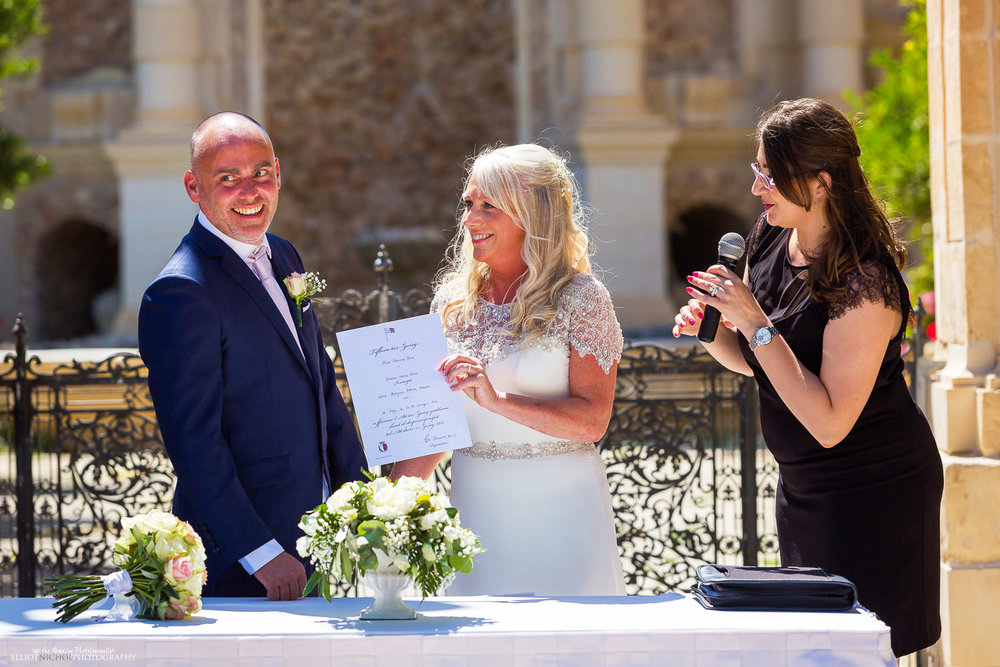 Bride and groom receive their marriage certificate from the Maltese Registrar.