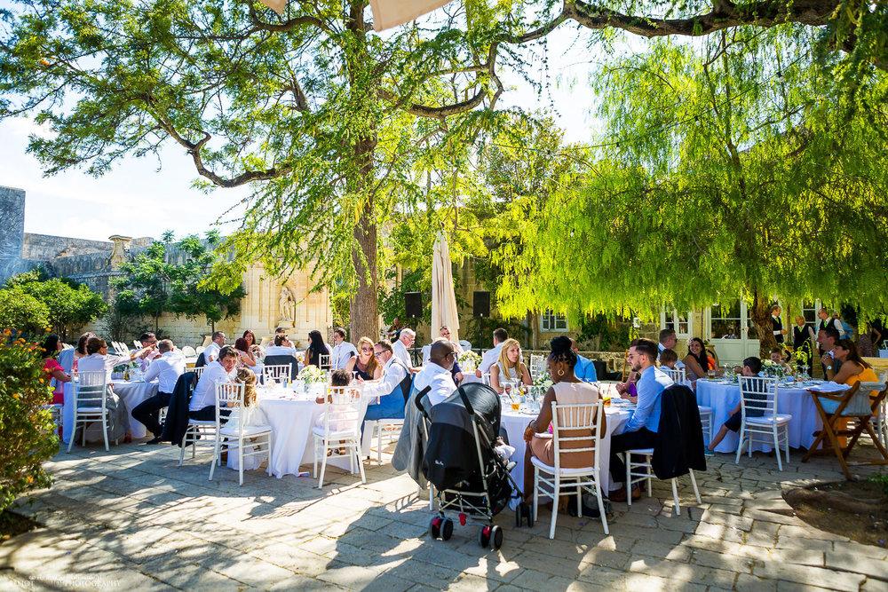 Wedding reception setup under the willow tress in the Baroque Gardens, Villa Bologna, Malta.