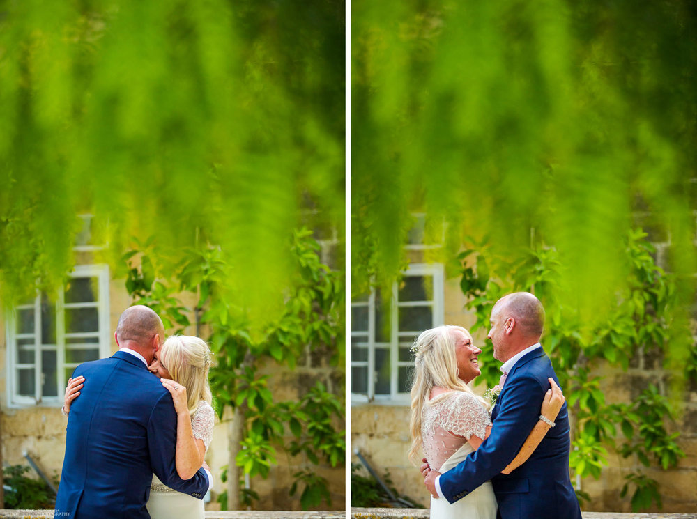 Husband and wife taking their first dance together under the willow trees in the Baroque Gardens at the Villa Bologna, Malta.