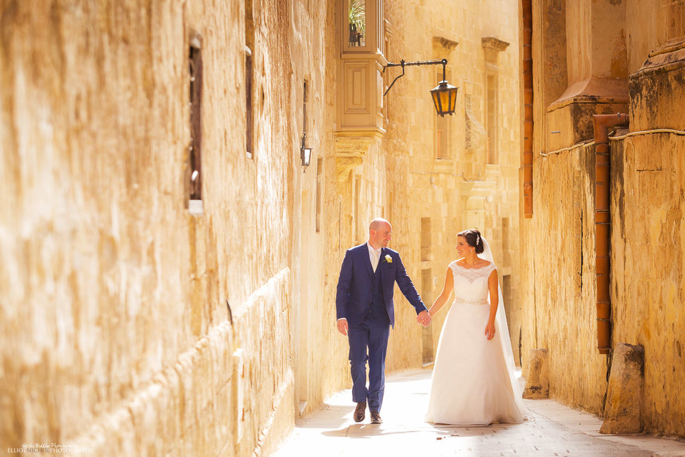 Bride and Groom walking through the medieval streets of Mdina, Malta