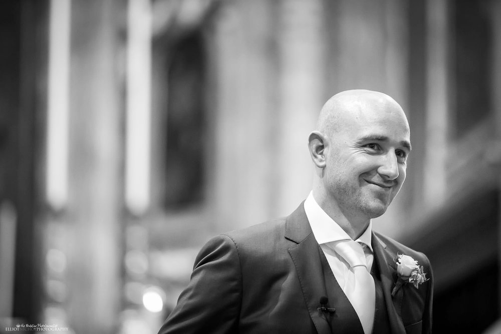 Groom waiting inside the cathedral for his bride to arrive at the wedding ceremony in Mdina, Malta.