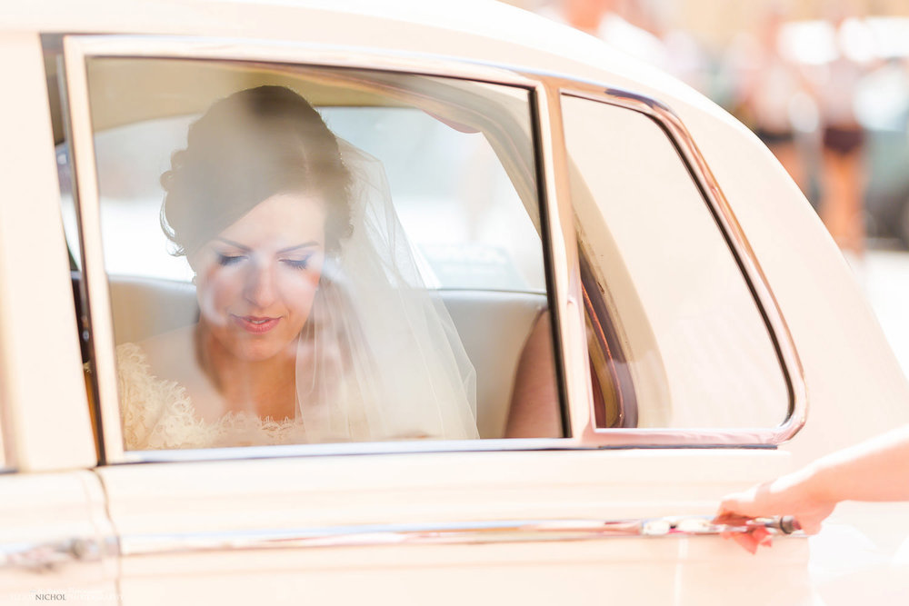 Bride arrives in a vintage Rolls Royce at St Paul's Cathedral, Mdina