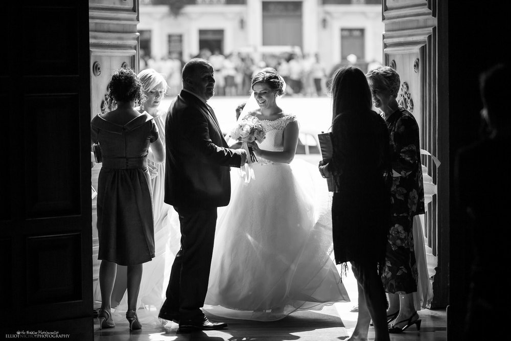 Bride arrives at Mdina Cathedral entrance on her wedding day.