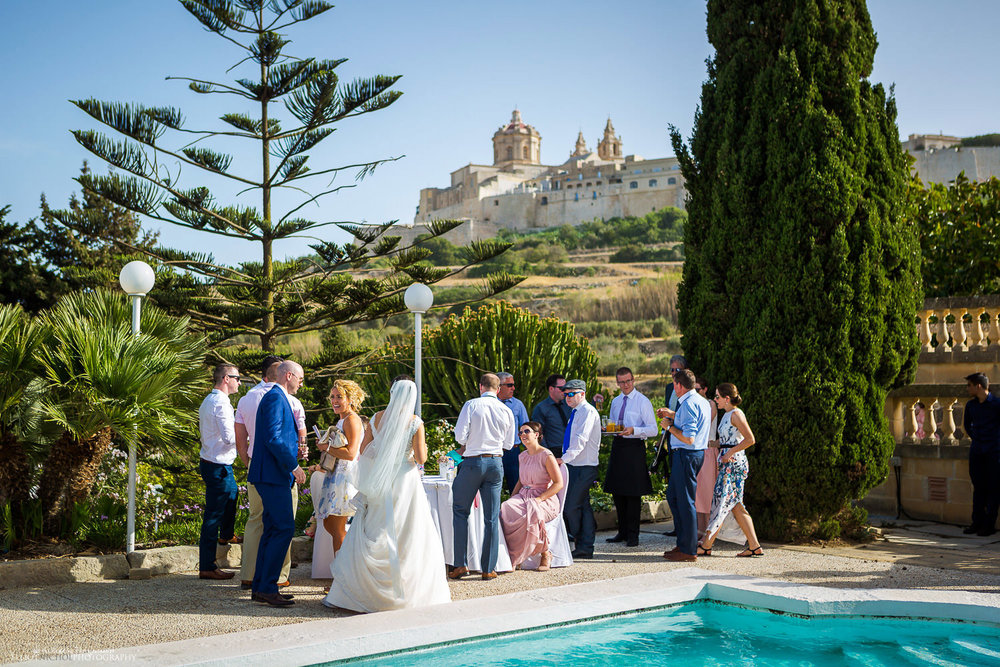 Bride and Groom arrive at their wedding reception venue the Olive Gardens, Mdina, Malta