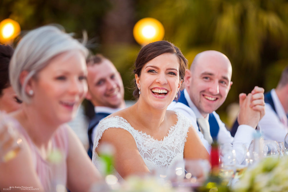 Bride laughing during the wedding speeches at Olive Gardens, Mdina