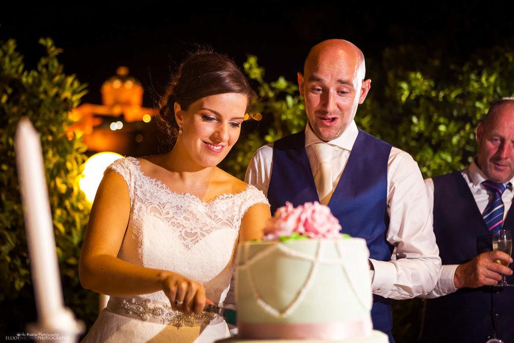Bride & Groom cutting their wedding cake at the Olive Gardens wedding venue in Mdina, Malta