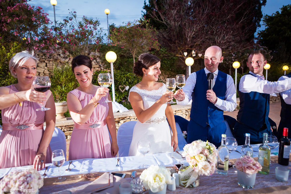 top table does it's wedding toast at the Olive Gardens, Mdina, Malta