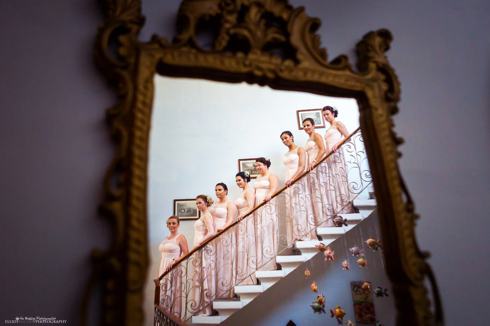 8 bridesmaids positioned on stairs reflected in a mirror in Malta.