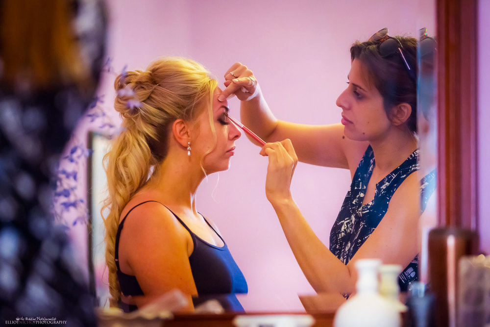 Bride with the makeup artist on the morning of her wedding day.