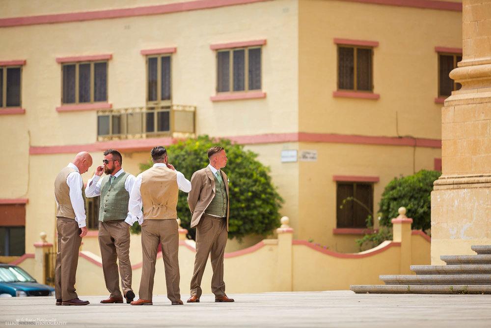 Groom and his groomsmen waiting outside St Peters Church, Birzebbuga, Malta
