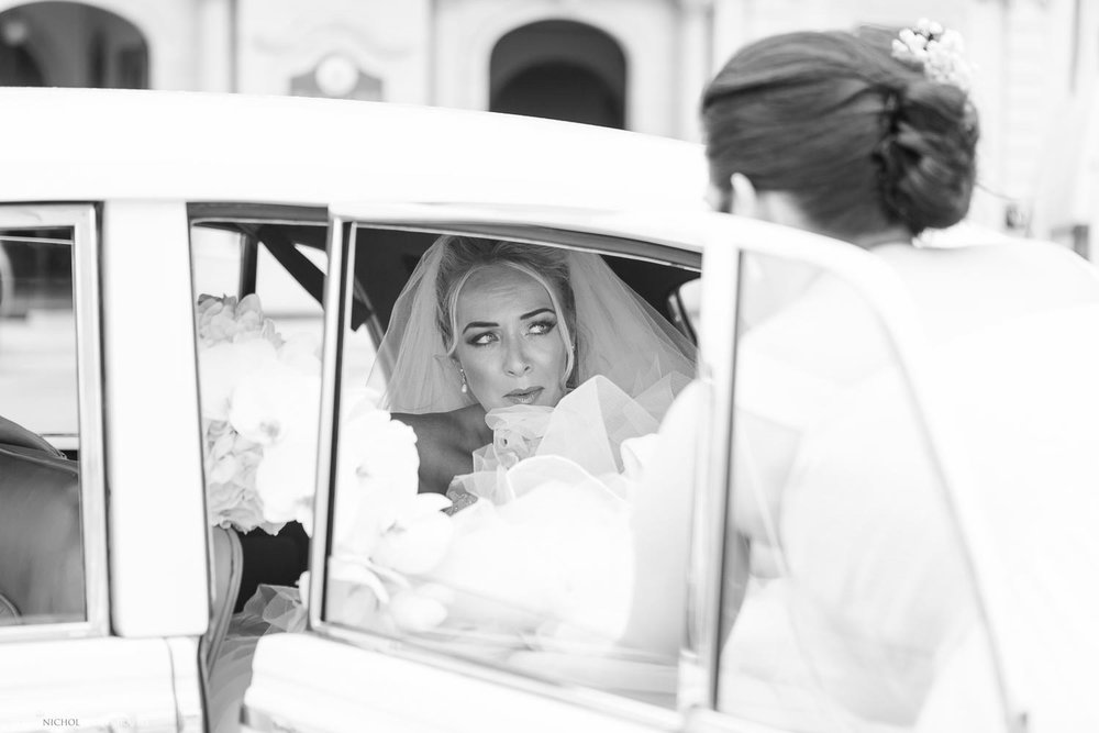 Bride arrives at church in a vintage Rolls Royce in Malta
