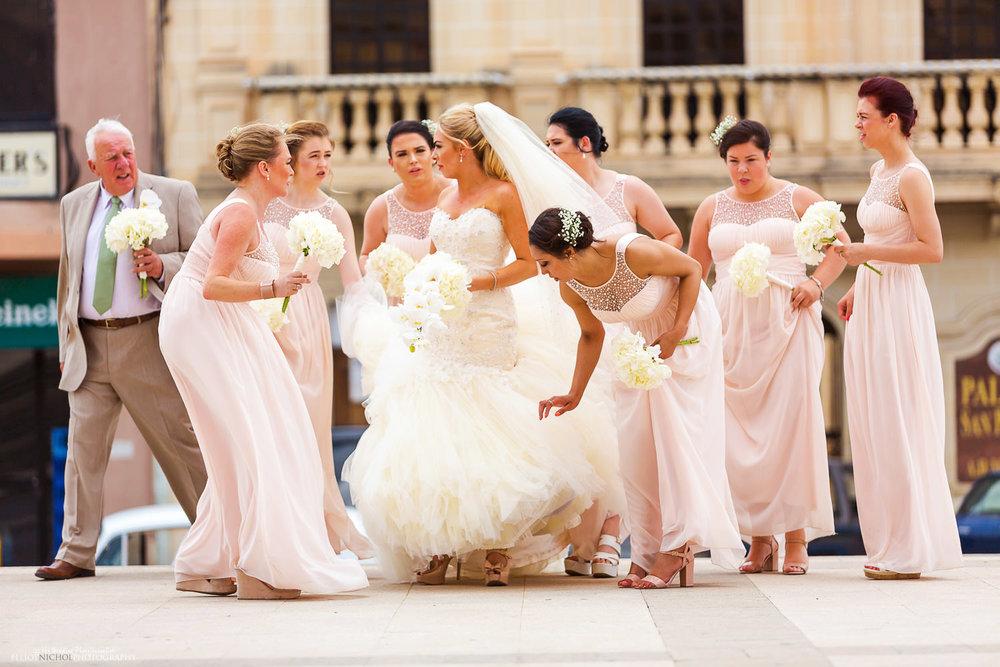 Brides wedding party arrives outside the church in Birzebbuga, Malta