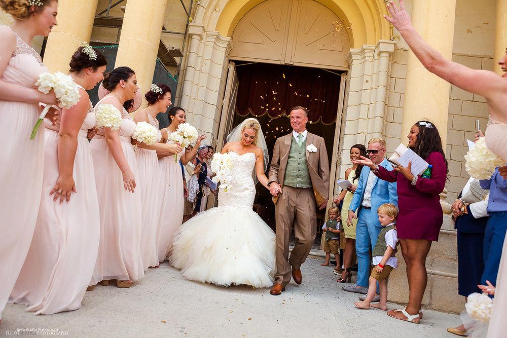Newlyweds leave St Peters Parish Church in Birzebbuga under a shower of confetti.