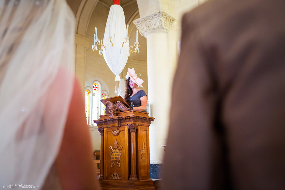 Wedding guest performs a reading during the church wedding ceremony, Malta.