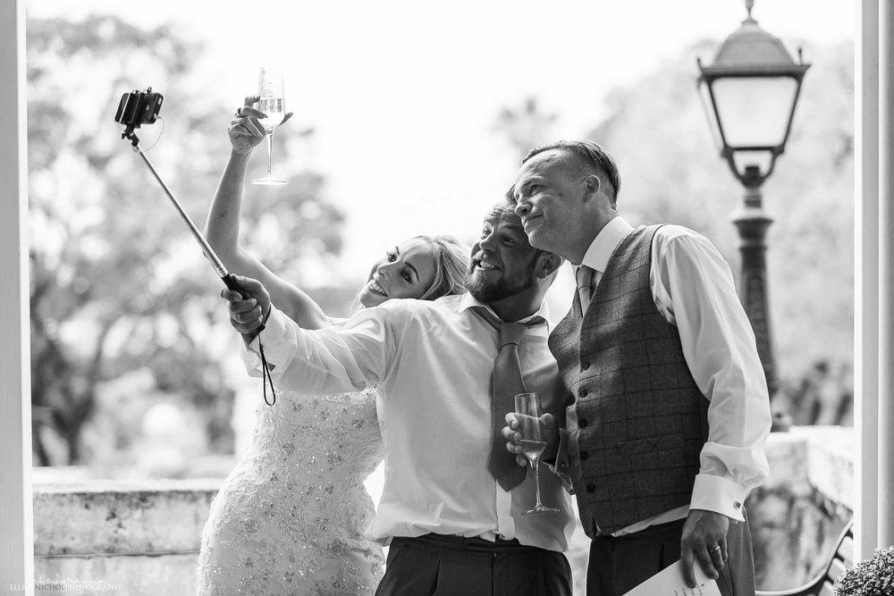 Bride, Groom and Bestman posing for a selfie